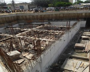 Scaffolding for water tank Slab preparation is under way at underground parking plaza