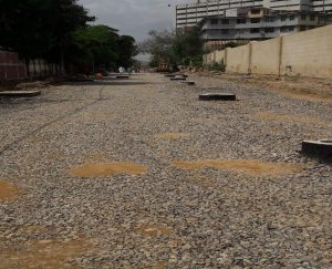 Stone ballast layer compaction is in process at Deen Mohammad Wafai Road ( 100-meter Stretch)
