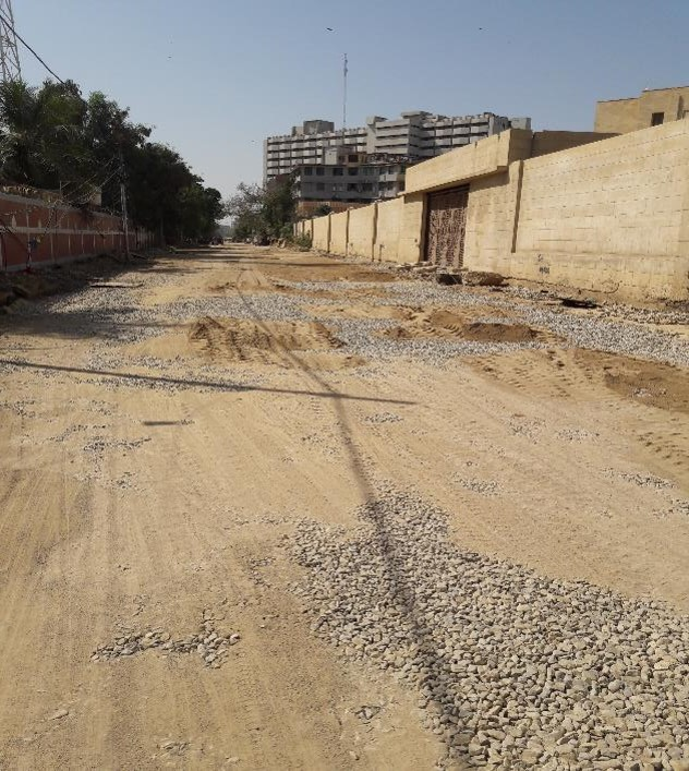 Final Layer of Aggregate Base Coarse is being prepared at Deen Mohammad Wafai Road  from Income Tax Building to Arts council Junction
