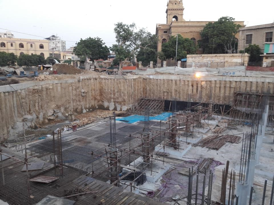 You are currently viewing Stone soling on grid 01 & 02 , PCC wall, foundation (Raft ) reinforcement , columns preparation are underway  at section 08 Underground Parking Plaza