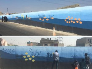 Artists painting walls in Korangi Area