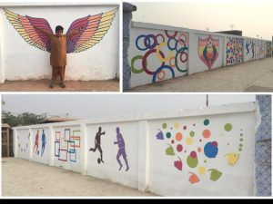 Empty walls cleaned up and painted to give a pleasant look of the area, at Korangi